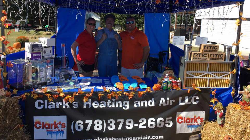 clark's heating and air team in a festival