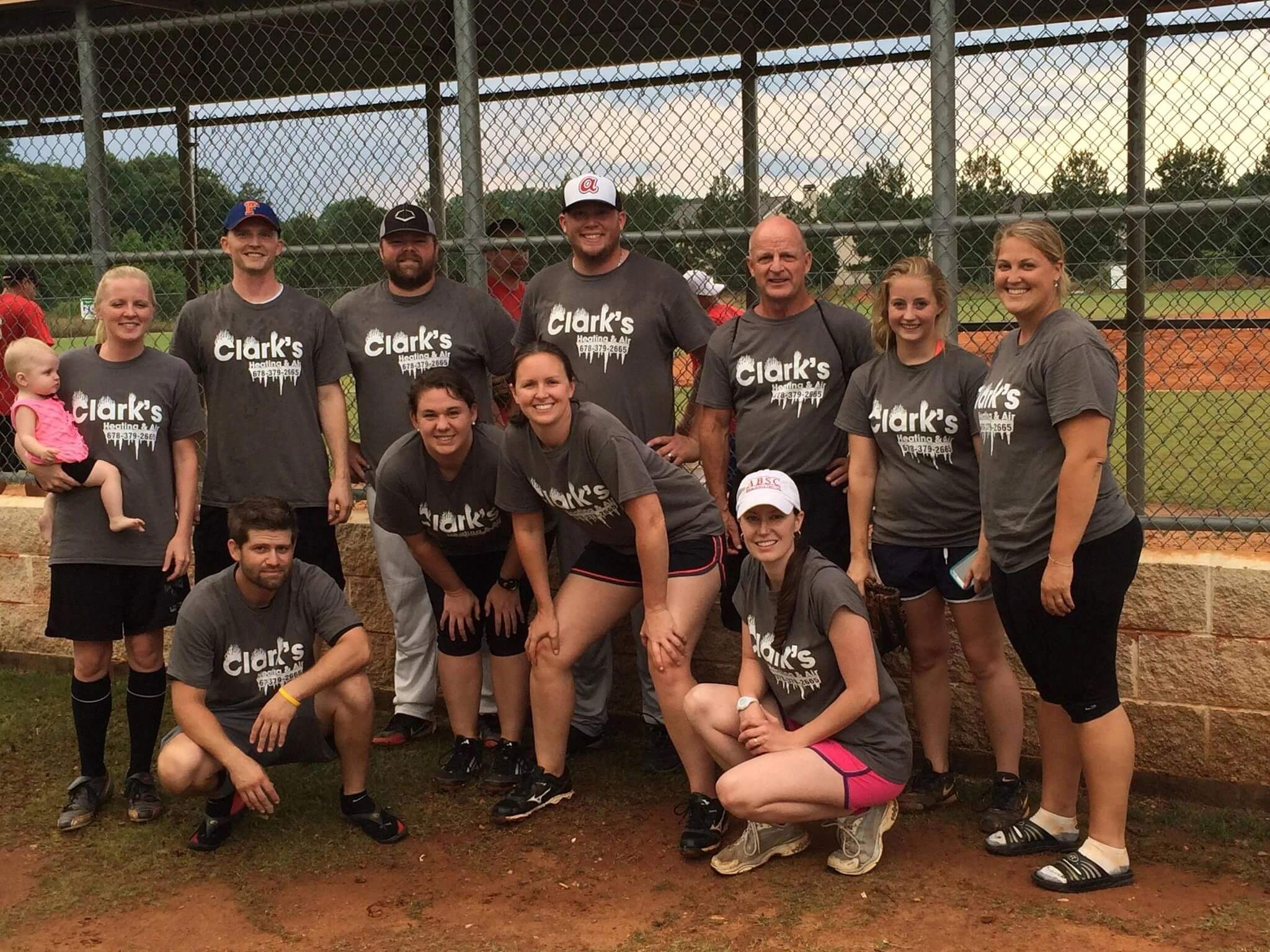 group of people wearing clark's heating and air shirts