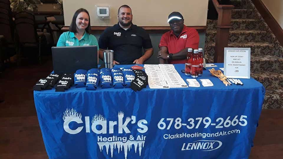 clark's heating and air team at a booth